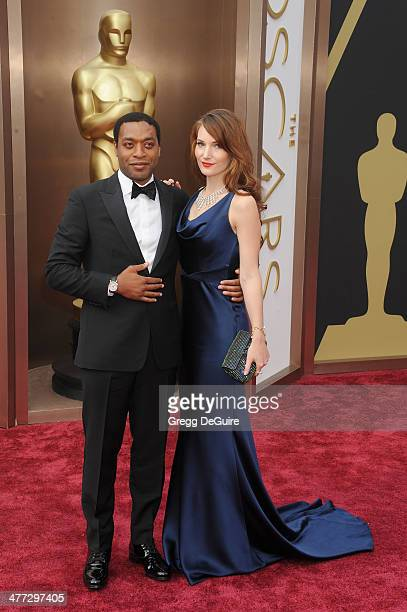 Actor Chiwetel Ejiofor and Sari Mercer arrive at the 86th Annual Academy Awards at Hollywood Highland Center on March 2 2014 in Hollywood California