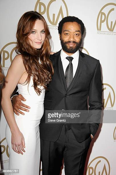 Actor Chiwetel Ejiofor and Sari Mercer attend the 25th annual Producers Guild of America Awards at The Beverly Hilton Hotel on January 19 2014 in...