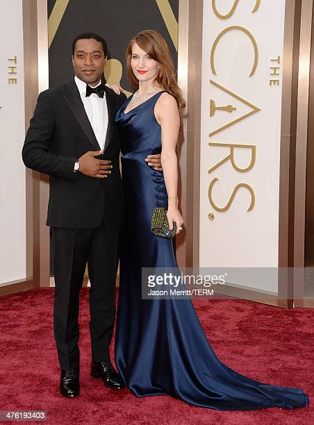 Actor Chiwetel Ejiofor and Sari Mercer attends the Oscars held at Hollywood Highland Center on March 2 2014 in Hollywood California