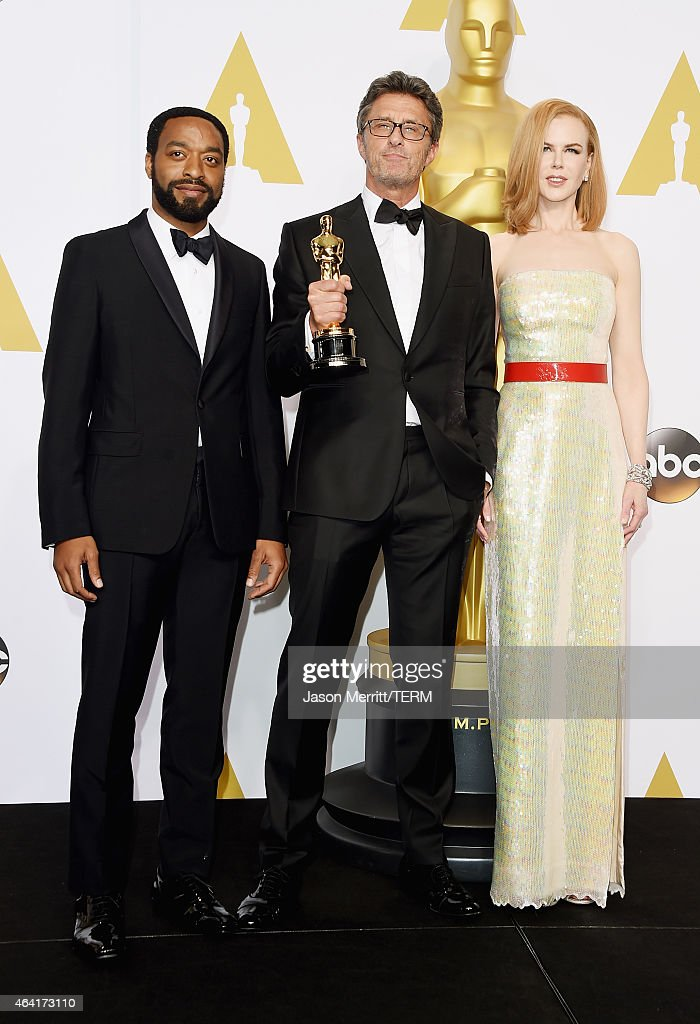 Actor Chiwetel Ejiofor, Filmmaker Pawel Pawlikowski winner of the Best Foreign Language Film Award for 'Ida', and actress Nicole Kidman pose in the press room during the 87th Annual Academy Awards at Loews Hollywood Hotel on February 22, 2015 in Hollywood, California.