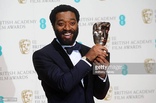 Actor Chiwetel Ejiofor winner of the Leading Actor award poses in the winners room at the EE British Academy Film Awards 2014 at The Royal Opera...