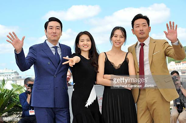 Actor Cho JinWoong actress Kim TaeRi actress Kim MinHee and actor Ha JungWoo attend The Handmaiden photocall during the 69th annual Cannes Film...