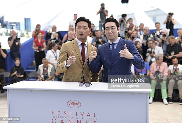 Actor Cho JinWoong and actor Ha JungWoo attend The Handmaiden photocall during the 69th annual Cannes Film Festival at the Palais des Festivals on...