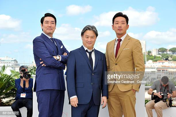 Actor Cho JinWoong director Park ChanWook and actor Ha JungWoo attend 'The Handmaiden ' photocall during the 69th annual Cannes Film Festival at the...