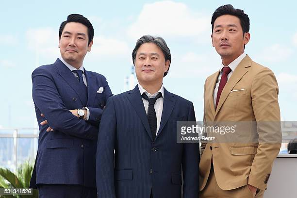 Actor Cho JinWoong director Park ChanWook and actor Ha JungWoo attend The Handmaiden photocall during the 69th annual Cannes Film Festival at the...