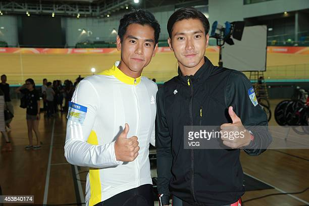 Actor Choi Siwon and actor Eddie Peng attend new movie shooting of 'To The Fore' on August 19 2014 in Hong Kong China