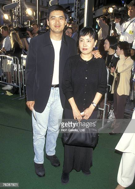 Actor Chow Yun Fat and wife Jasmine Chow attend the Godzilla New York City Premiere on May 18 1998 at Madison Square Garden in New York City New York