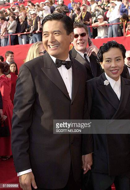 Actor Chow Yun Fat arrives with his wife Jasmine 25 March 2001 for the 73rd Annual Academy Awards in Los Angeles CA Chow Yun Fat stars in the movie...