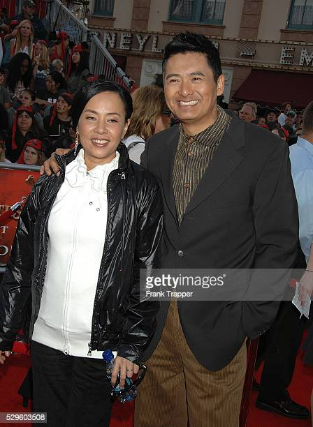 Actor Chow YunFat and wife Jasmine arrive at the world premiere of Pirates of the Caribbean At World's End held at Disneyland in Anaheim