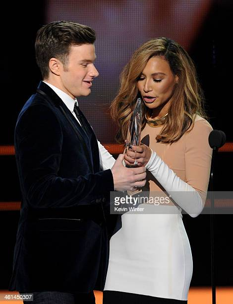 Actor Chris Colfer accepts the Favorite Comedic TV Actor award for Glee from actress Naya Rivera onstage at The 40th Annual People's Choice Awards at...