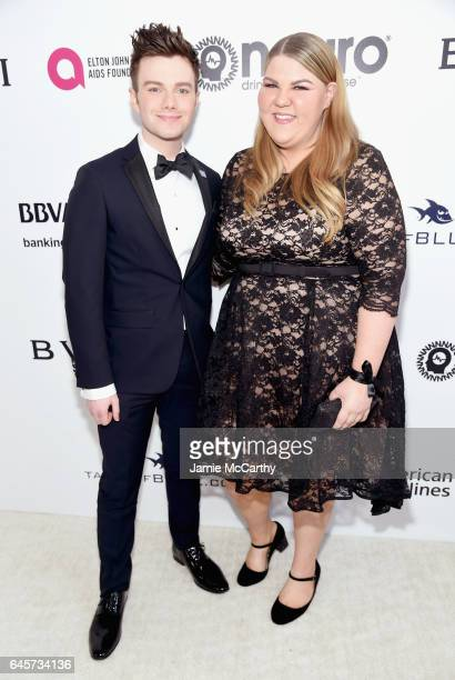 Actor Chris Colfer and Actor Ashley Fink attends the 25th Annual Elton John AIDS Foundation's Academy Awards Viewing Party at The City of West...