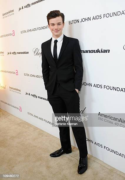 Actor Chris Colfer arrives at the 19th Annual Elton John AIDS Foundation Academy Awards Viewing Party at the Pacific Design Center on February 27...