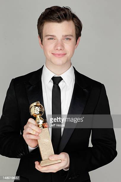 Actor Chris Colfer poses with his award for Best Performance by an Actor in a Supporting Role in a Series MiniSeries or Motion Picture Made for...