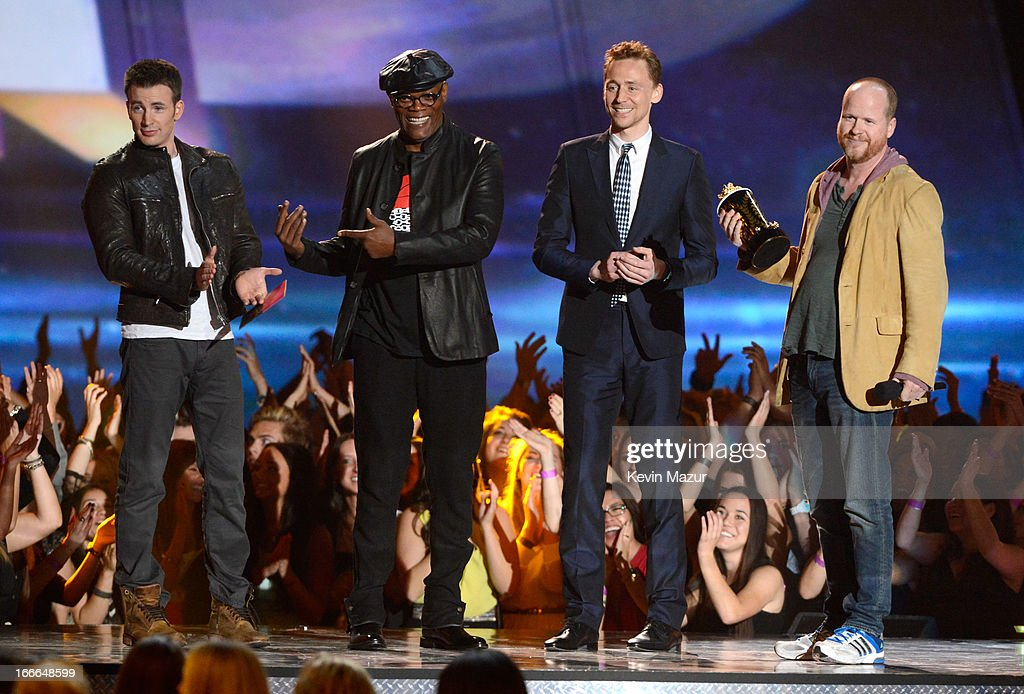 Actor Chris Evans, actor Samuel L. Jackson, actor Tim Hiddleston and filmmaker Joss Whedon speak onstage during the 2013 MTV Movie Awards at Sony Pictures Studios on April 14, 2013 in Culver City, California.