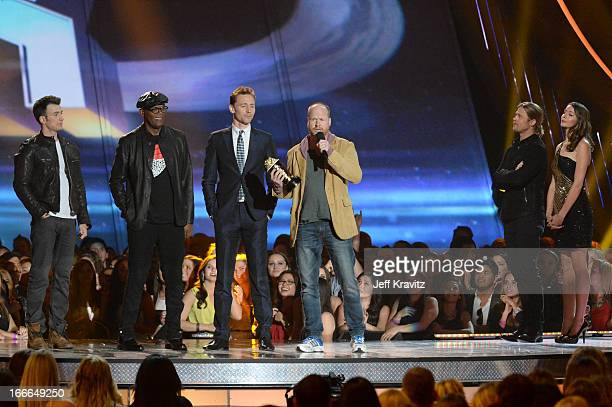 Actor Chris Evans actor Samuel L Jackson actor Tim Hiddleston and filmmaker Joss Whedon speak as actor Brad Pitt and stands nearby onstage during the...