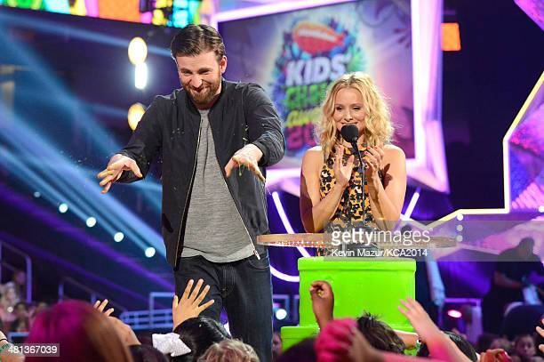 Actor Chris Evans and actress Kristen Bell speak onstage during Nickelodeon's 27th Annual Kids' Choice Awards held at USC Galen Center on March 29...