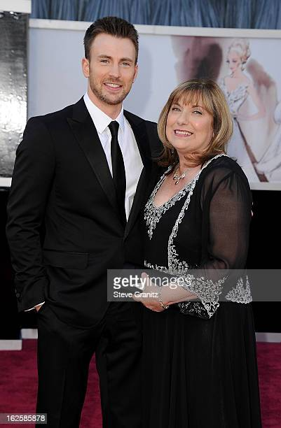 Actor Chris Evans and guest arrive at the Oscars at Hollywood Highland Center on February 24 2013 in Hollywood California