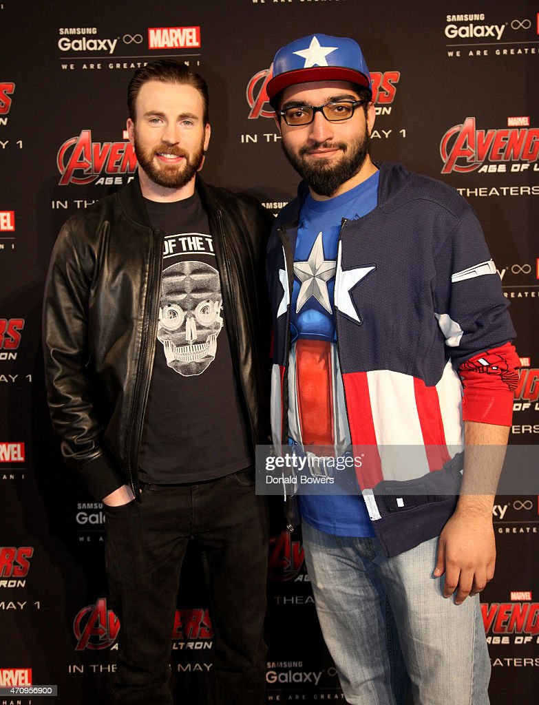 Samsung galaxy studio hosts chris evans fan meet and greet photos actor chris evans l and guest attend samsung galaxy studio hosts chris evans fan m4hsunfo