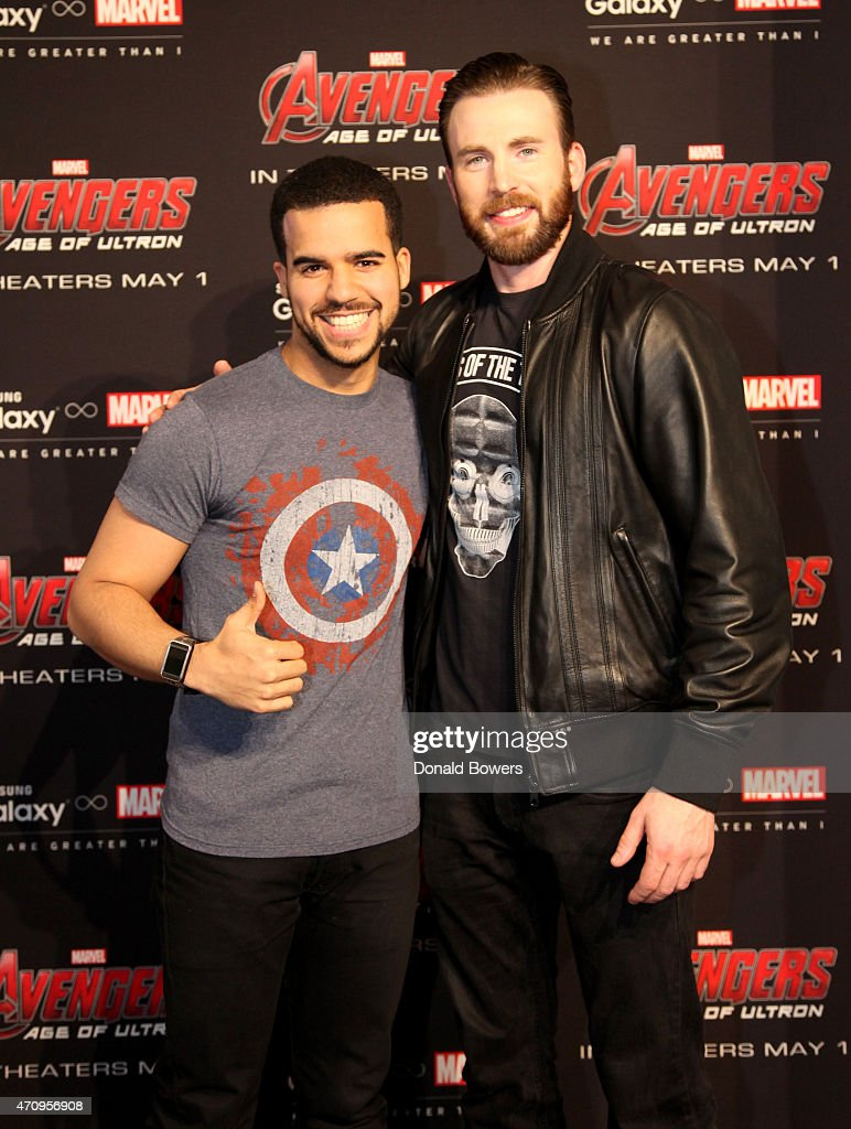Samsung galaxy studio hosts chris evans fan meet and greet photos actor chris evans r and guest attend samsung galaxy studio hosts chris evans fan m4hsunfo