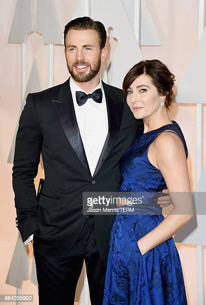 Actor Chris Evans and guest attend the 87th Annual Academy Awards at Hollywood Highland Center on February 22 2015 in Hollywood California