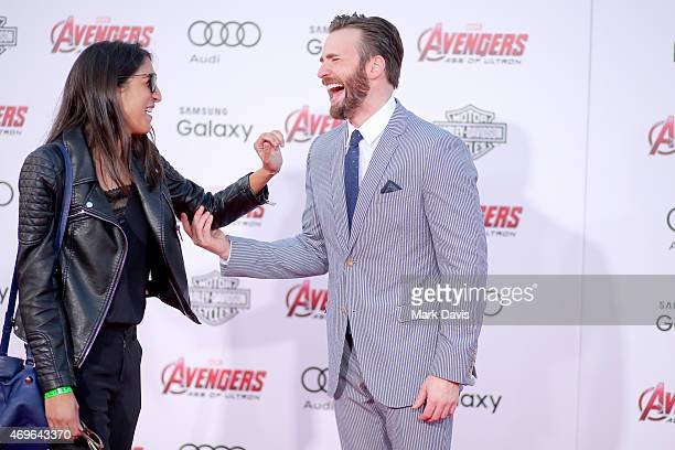 """Actor Chris Evans and guest attend the premiere of Marvel's """"Avengers: Age Of Ultron"""" at Dolby Theatre on April 13, 2015 in Hollywood, California."""