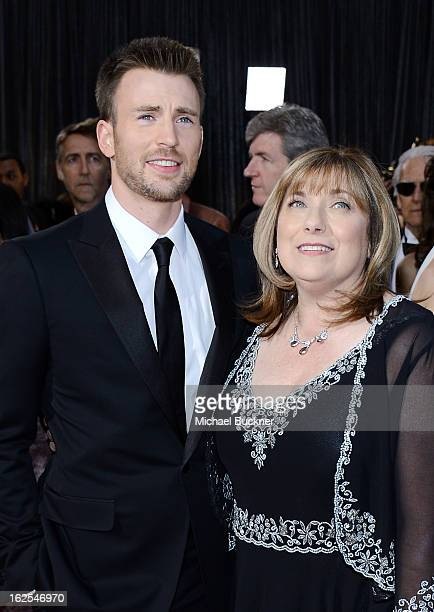 Actor Chris Evans and his mother Lisa Evans arrive at the Oscars at Hollywood Highland Center on February 24 2013 in Hollywood California