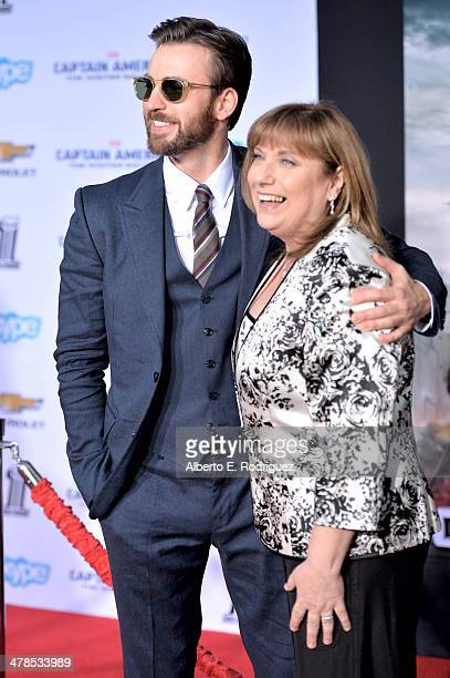 Actor Chris Evans and Lisa Evans attend Marvel's Captain America The Winter Soldier premiere at the El Capitan Theatre on March 13 2014 in Hollywood...