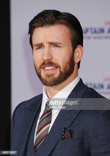 Actor Chris Evans arrives at the Los Angeles premiere of 'Captain America The Winter Soldier' at the El Capitan Theatre on March 13 2014 in Hollywood...
