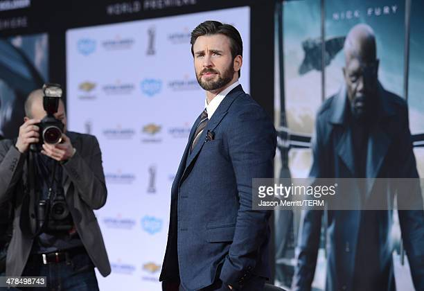 "Actor Chris Evans arrives for the premiere of Marvel's ""Captain America: The Winter Soldier"" at the El Capitan Theatre on March 13, 2014 in..."