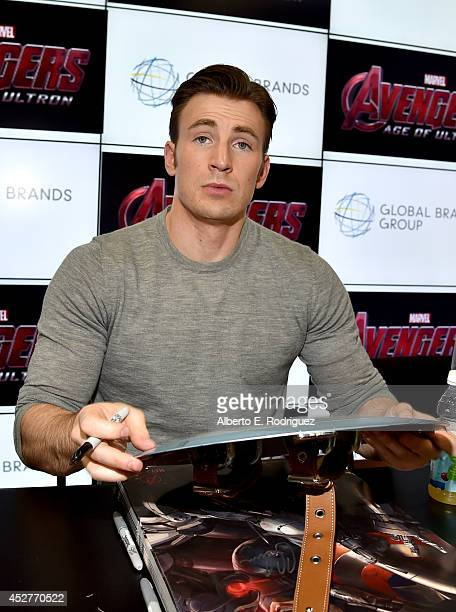 Actor Chris Evans attends Marvel's Avengers Age Of Ultron Hall H Panel Booth Signing during ComicCon International 2014 at San Diego Convention...