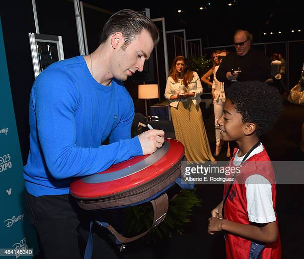 Actor Chris Evans of CAPTAIN AMERICA CIVIL WAR and actor Miles Brown took part today in 'Worlds Galaxies and Universes Live Action at The Walt Disney...