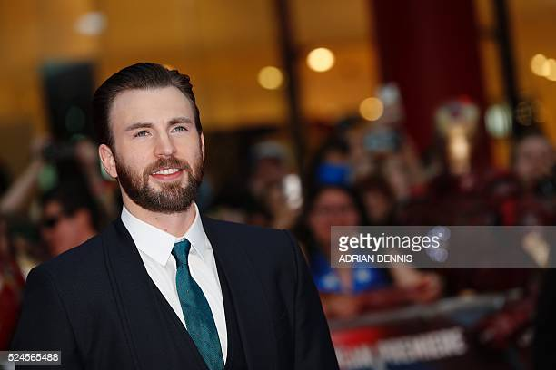 US actor Chris Evans poses on the red carpet arriving for the European Premiere of the film Captain America Civil War in London on April 26 2016 /...