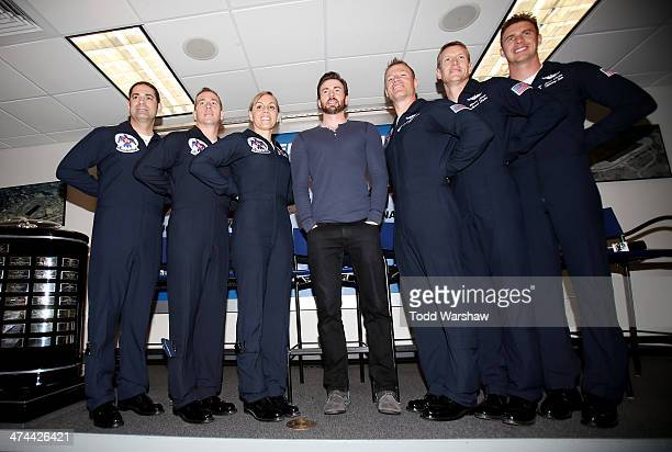 Actor Chris Evans poses with members of the US Air Force Thunderbirds prior to the NASCAR Sprint Cup Series Daytona 500 at Daytona International...