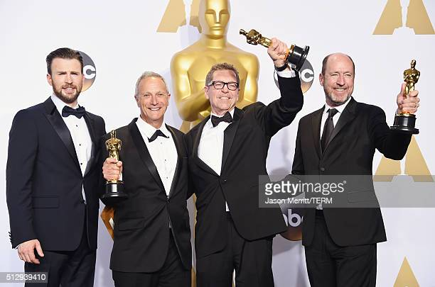 Actor Chris Evans sound editors Ben Osmo Gregg Rudloff and Chris Jenkins winners of Best Sound Mixing for 'Mad Mad Road Fury' pose in the press room...