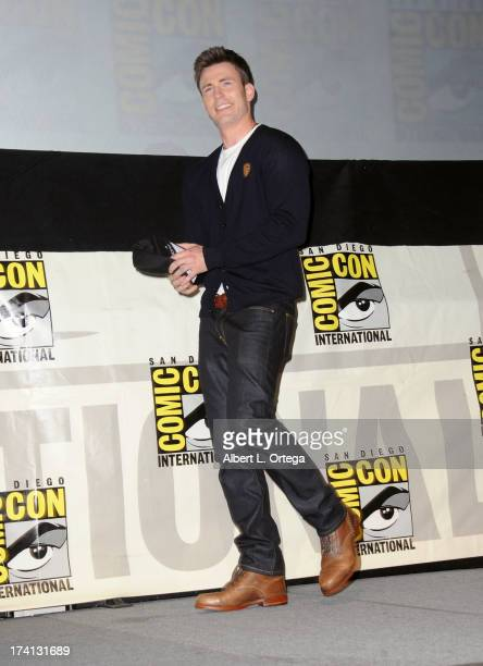 Actor Chris Evans speaks onstage at Marvel Studios 'Thor The Dark World' and 'Captain America The Winter Soldier' during ComicCon International 2013...