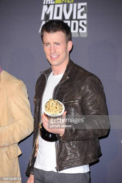 """Actor Chris Evans, winner of Movie of the Year Award for """"The Avengers"""", poses at the 2013 MTV Movie Awards Photo Pressroom at Sony Pictures Studios..."""