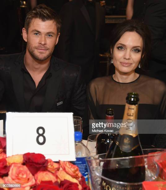 Actor Chris Hemsworth and actor/filmmaker Angelina Jolie celebrate The 75th Annual Golden Globe Awards with Moet Chandon at The Beverly Hilton Hotel...