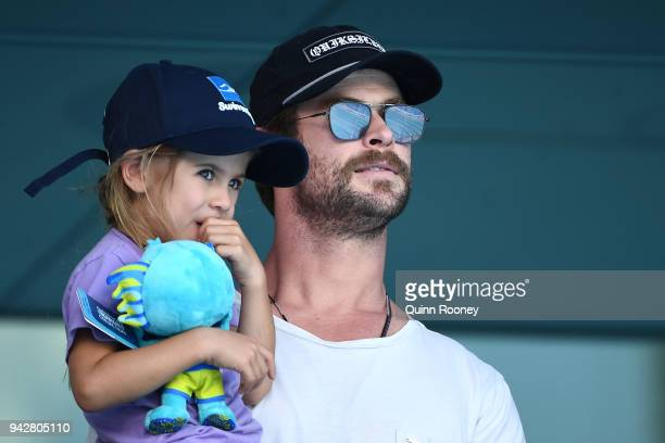 Actor Chris Hemsworth and daughter India Rose Hemsworth attend the swimming on day three of the Gold Coast 2018 Commonwealth Games at Optus Aquatic...
