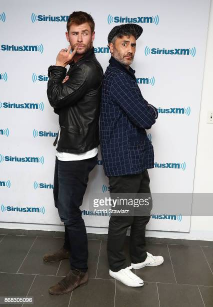 Actor Chris Hemsworth and director Taika Waititi pose for photos during SiriusXM's 'EW Spotlight' With Chris Hemsworth And Taika Waititi at SiriusXM...