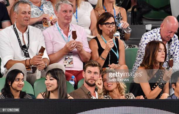 Actor Chris Hemsworth and his wife Elsa Pataky watch as Croatia's Marin Cilic plays against Switzerland's Roger Federer during their men's singles...