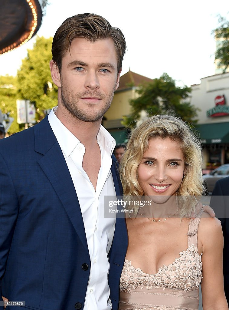 Actor Chris Hemsworth (L) and his wife model Elsa Pataky arrive at the premiere of Warner Bros. Pictures' 'Vacation' at the Village Theatre on July 27, 2015 in Los Angeles, California.
