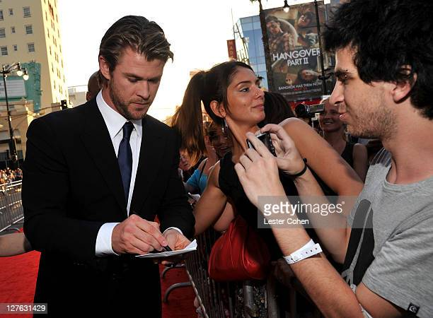 """Actor Chris Hemsworth arrives at the Los Angeles premiere of """"Thor"""" at the El Capitan Theatre on May 2, 2011 in Hollywood, California."""