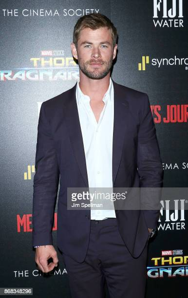 Actor Chris Hemsworth attends the screening of Marvel Studios' 'Thor Ragnarok' hosted by The Cinema Society with FIJI Water Men's Journal and...