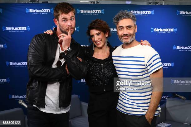 Actor Chris Hemsworth SiriusXM host Jessica Shaw and director Taika Waititi pose for photos during SiriusXM's 'EW Spotlight' With Chris Hemsworth And...