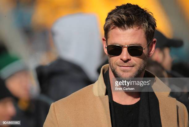 Actor Chris Hemsworth watches warmups before the AFC Divisional Playoff game between the Pittsburgh Steelers and the Jacksonville Jaguars at Heinz...