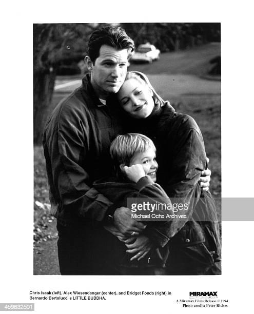 Actor Chris Isaak actress Bridget Fonda and actor Alex Wiesendanger on the set of the Miramax Film movie Little Buddha circa 1993