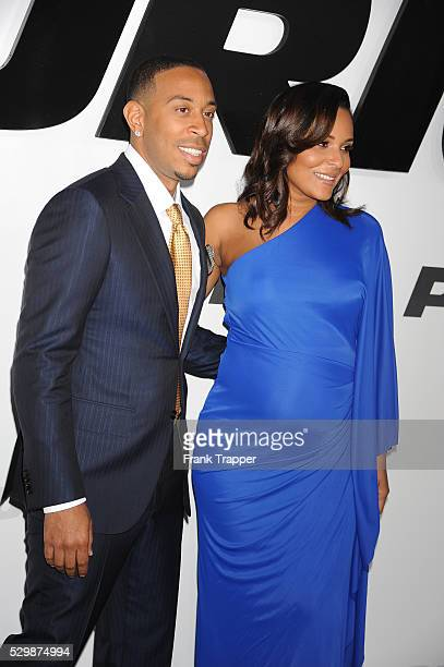 Actor Chris 'Ludacris' Bridges and guest arrive at the premiere of Furious 7 held at the TCL Chinese Theater in Hollywood