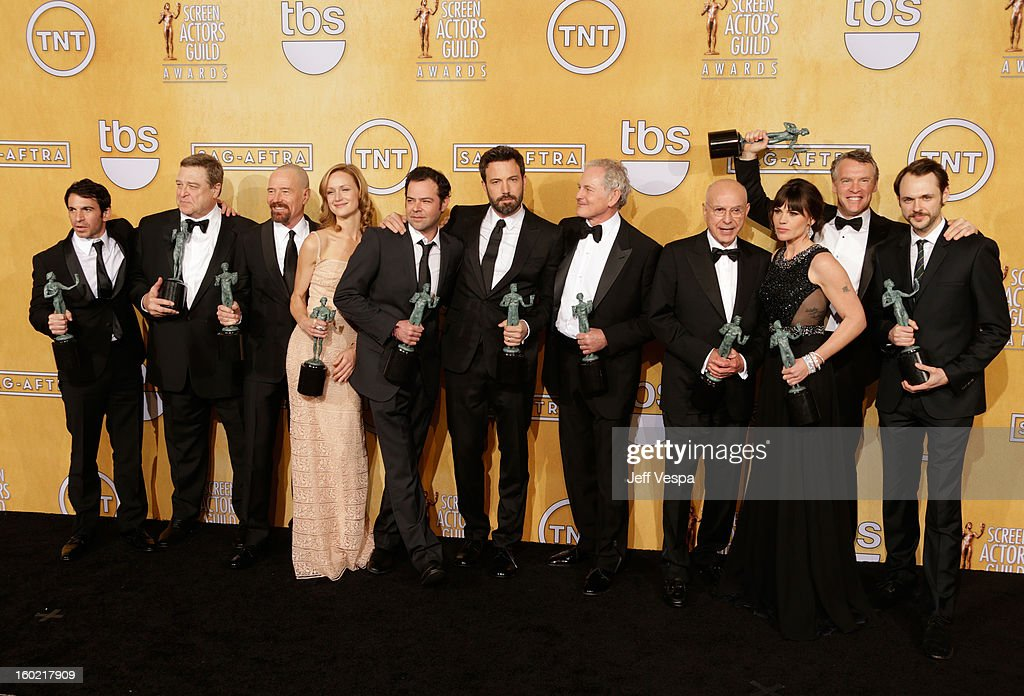 Actor Chris Messina, actor John Goodman, actor Bryan Cranston, actor Kerry Bishe, actor Rory Cochrane, actor/director Ben Affleck, actor Victor Garber, actor Alan Arkin, actor Clea DuVall, actor Tate Donovan, and actor Christopher Denham pose in the press room during the 19th Annual Screen Actors Guild Awards held at The Shrine Auditorium on January 27, 2013 in Los Angeles, California.