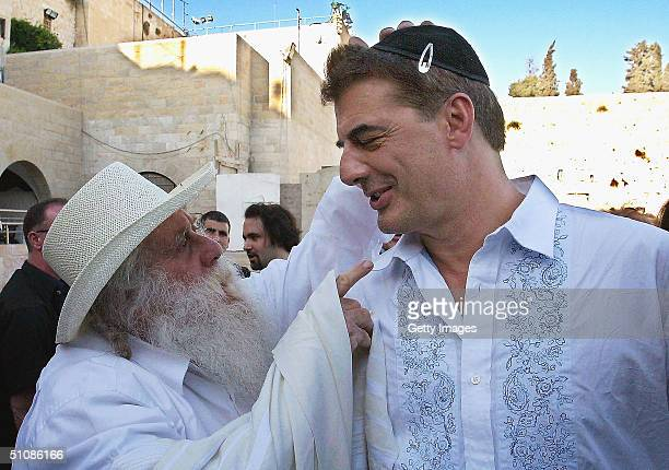 Actor Chris Noth from the popular TV sitcom Sex and the City is blessed by Moti a religious Israeli during a visit to the site of the Western Wall...