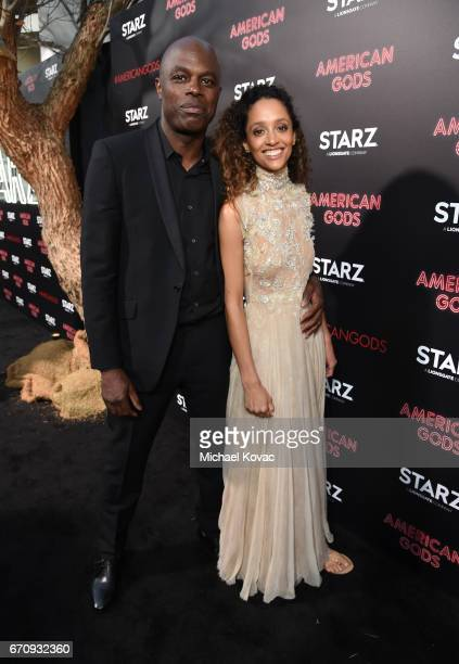 """Actor Chris Obi and guest attend the """"American Gods"""" premiere at ArcLight Hollywood on April 20, 2017 in Los Angeles, California."""